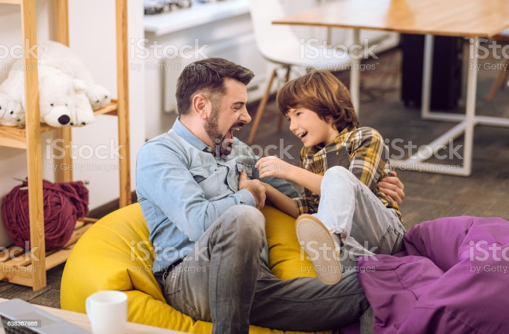 Dad and little boy expressing happiness stock photo