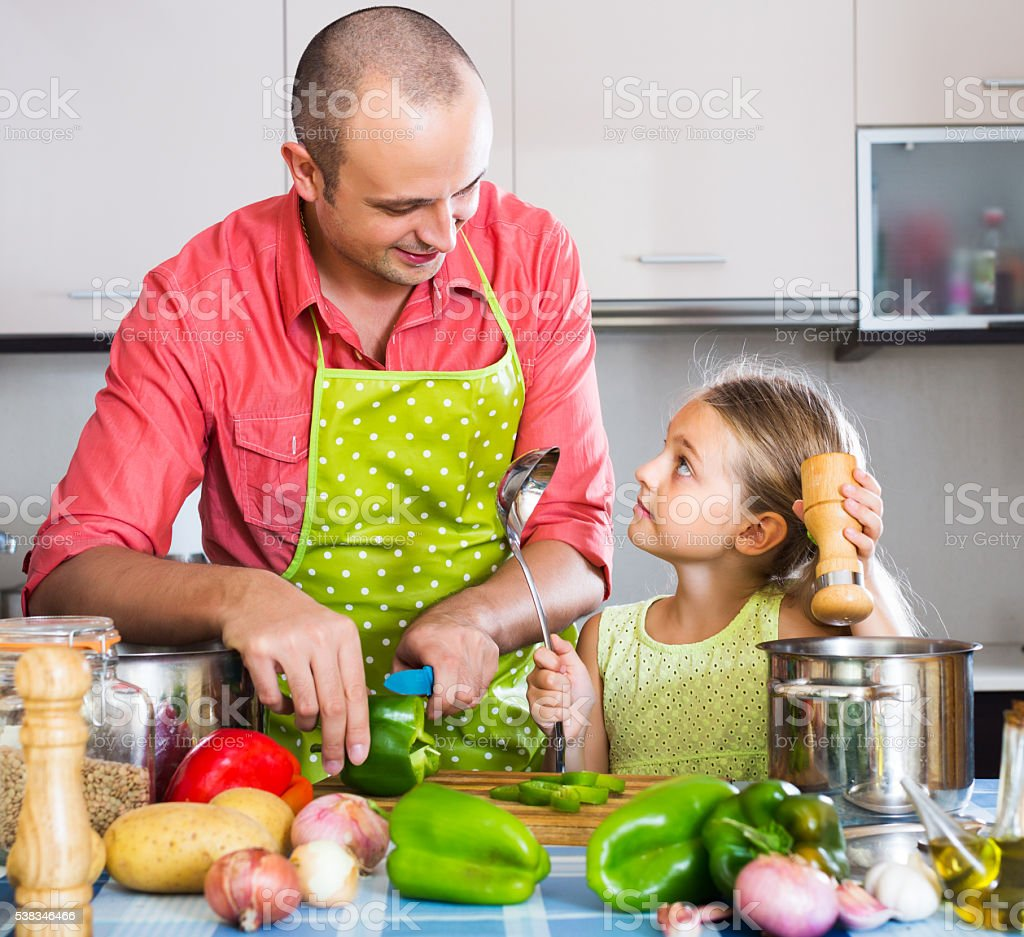 Dad and little daughter cooking stock photo