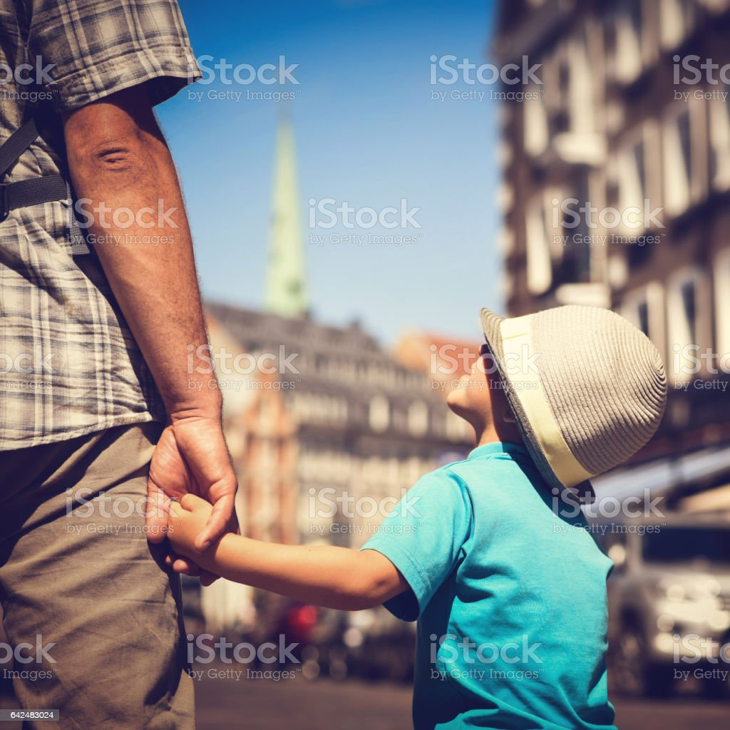 Dad and son are traveling together stock photo