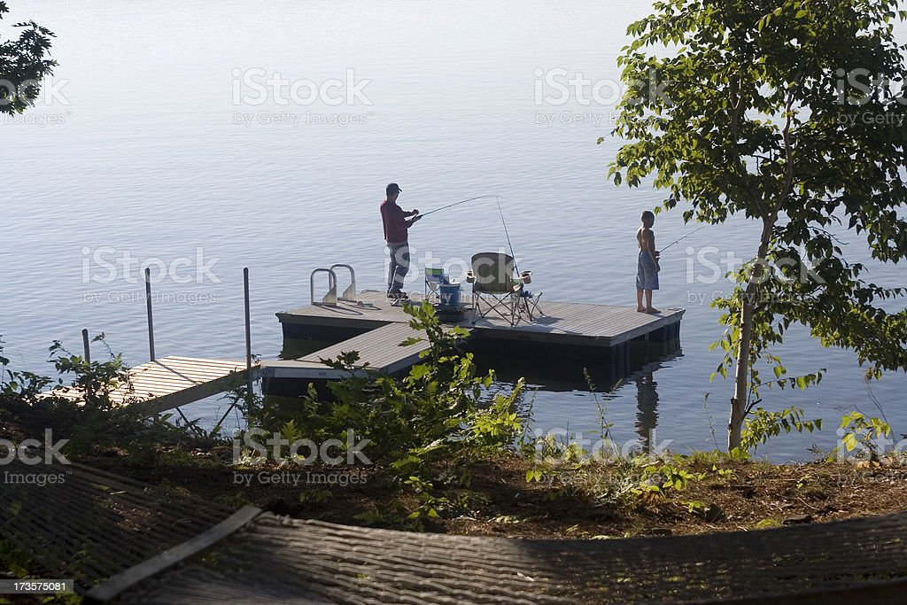 Dad and son fishing royalty-free stock photo