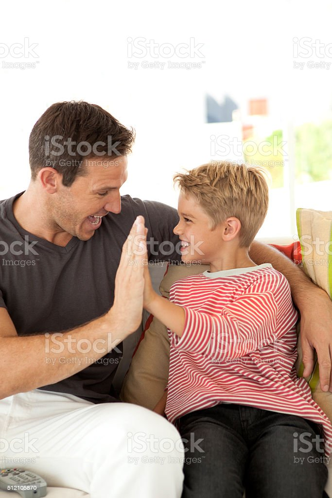 Dad and Son high five stock photo