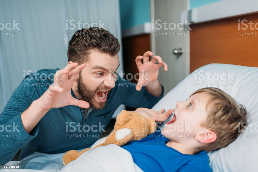 dad and son in hospital chamber stock photo