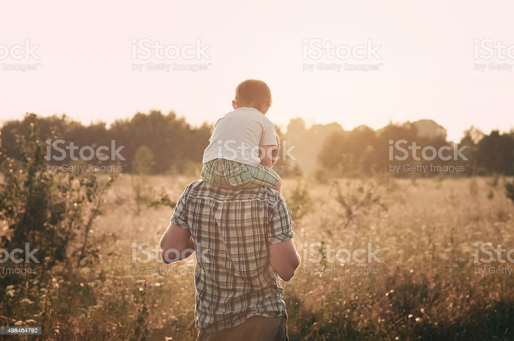 Dad and son together stock photo