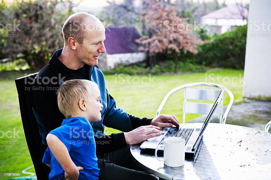 Dad and son with computer (series) royalty-free stock photo