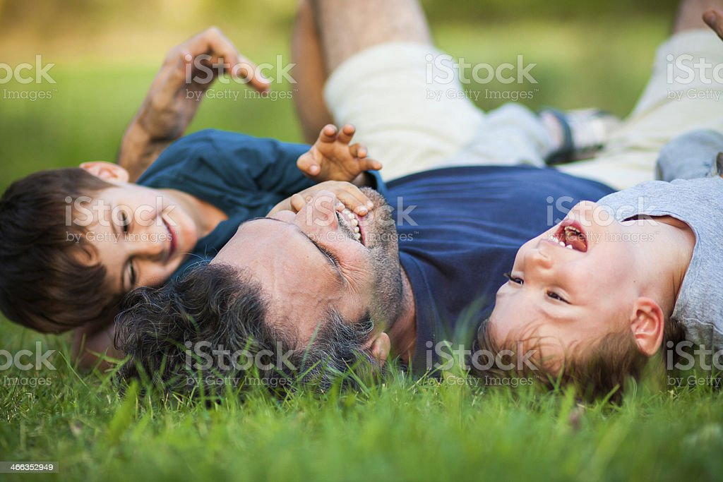 Dad and the boys stock photo