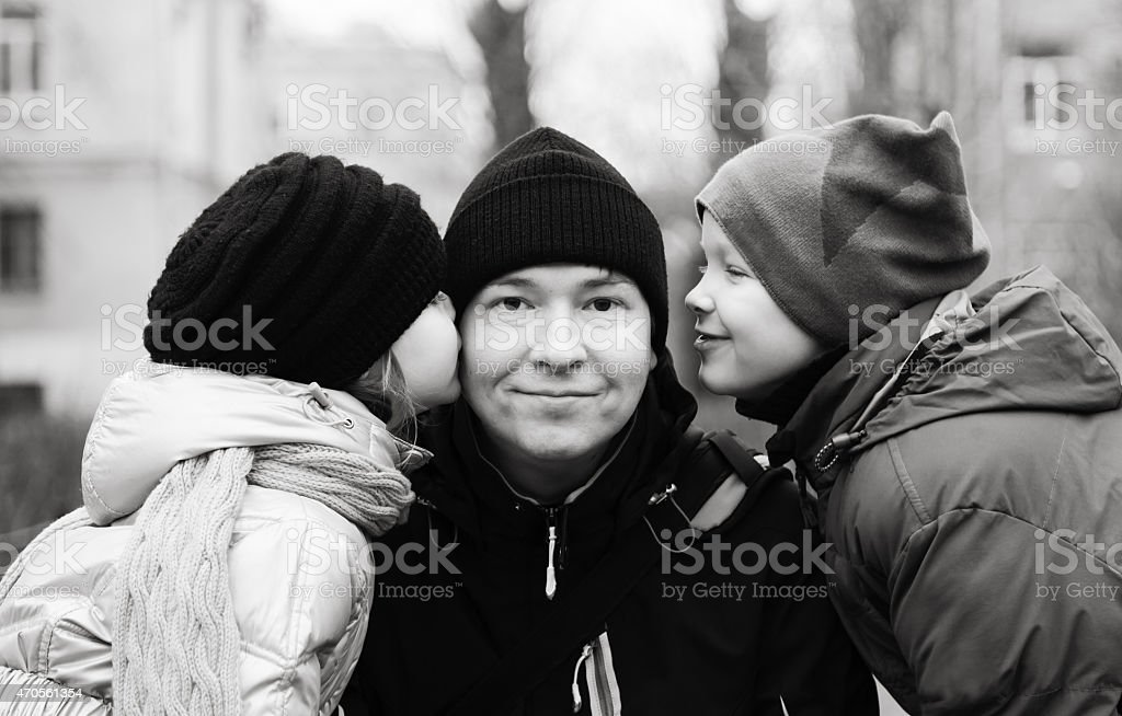Dad and two children stock photo