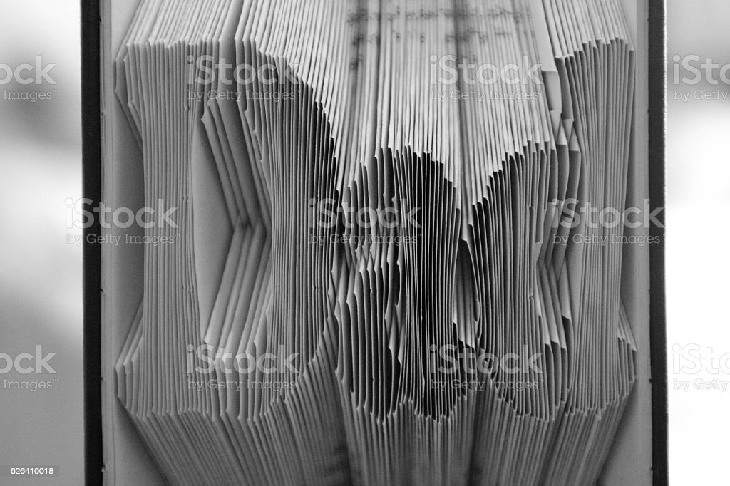 Dad folded into a book pages stock photo