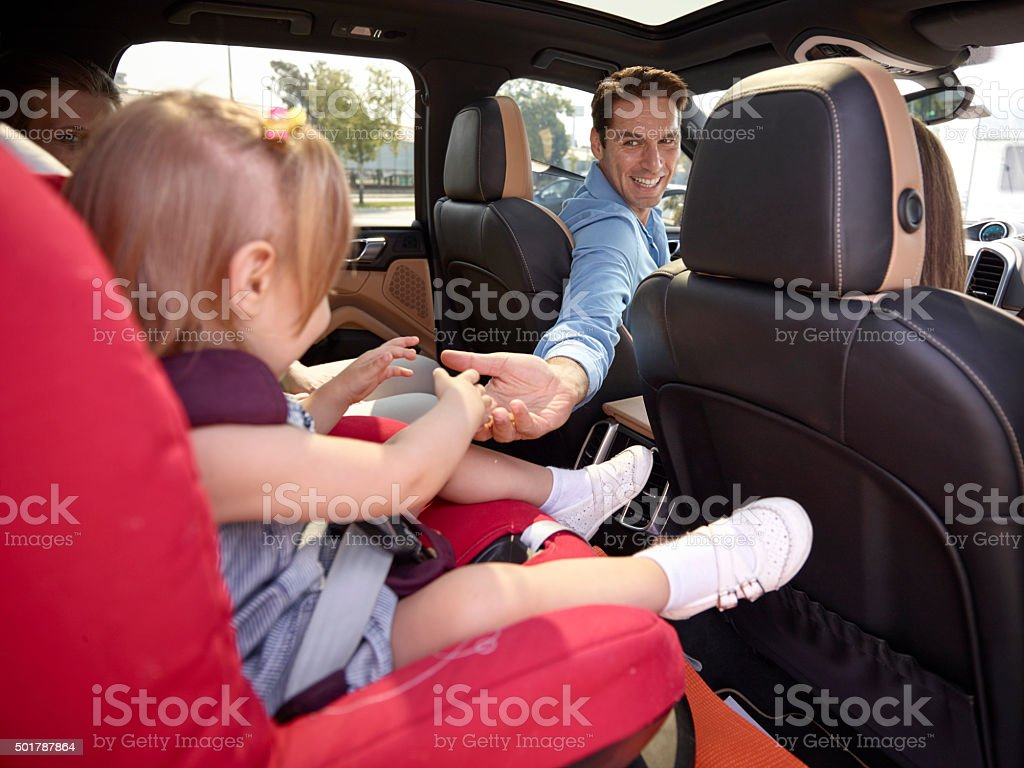 Dad goes back to the girl in the car stock photo