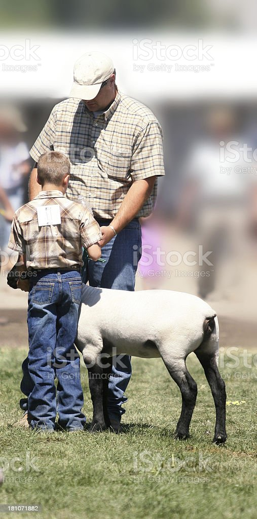Dad Helping His Son royalty-free stock photo