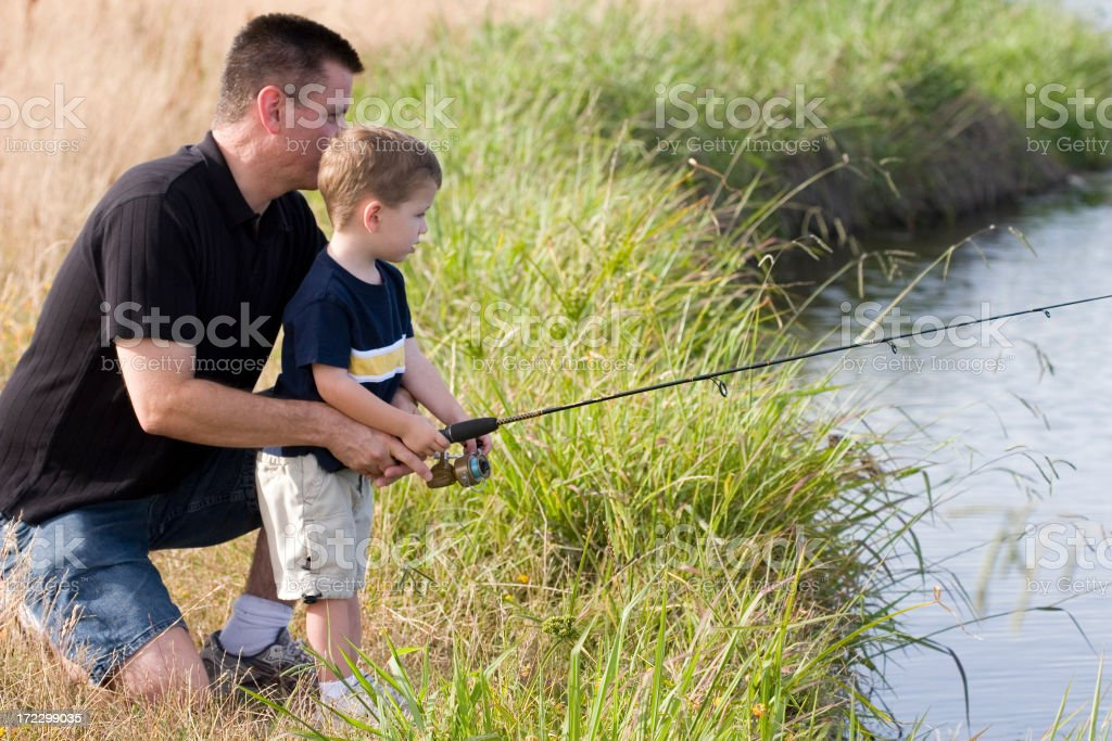 Dad Helping Son Fish royalty-free stock photo
