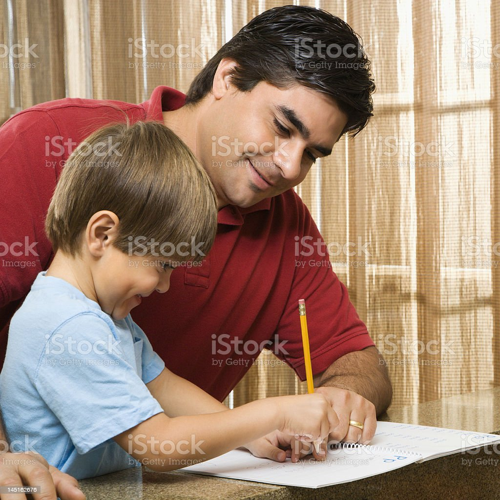 Dad helping son. royalty-free stock photo