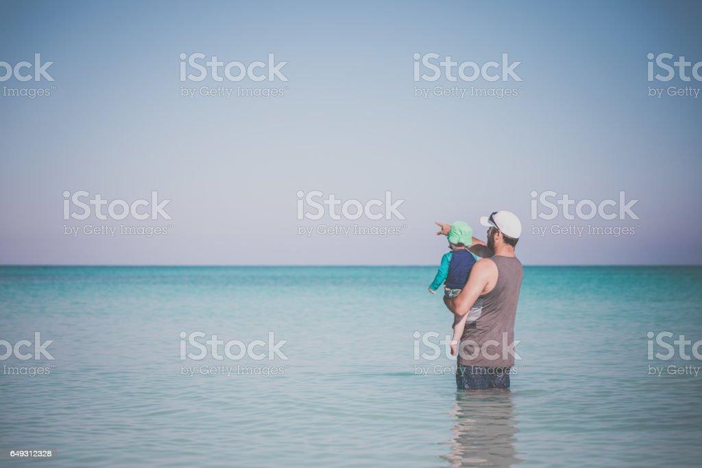 Dad Holding Baby Boy at Beach, Cuba stock photo