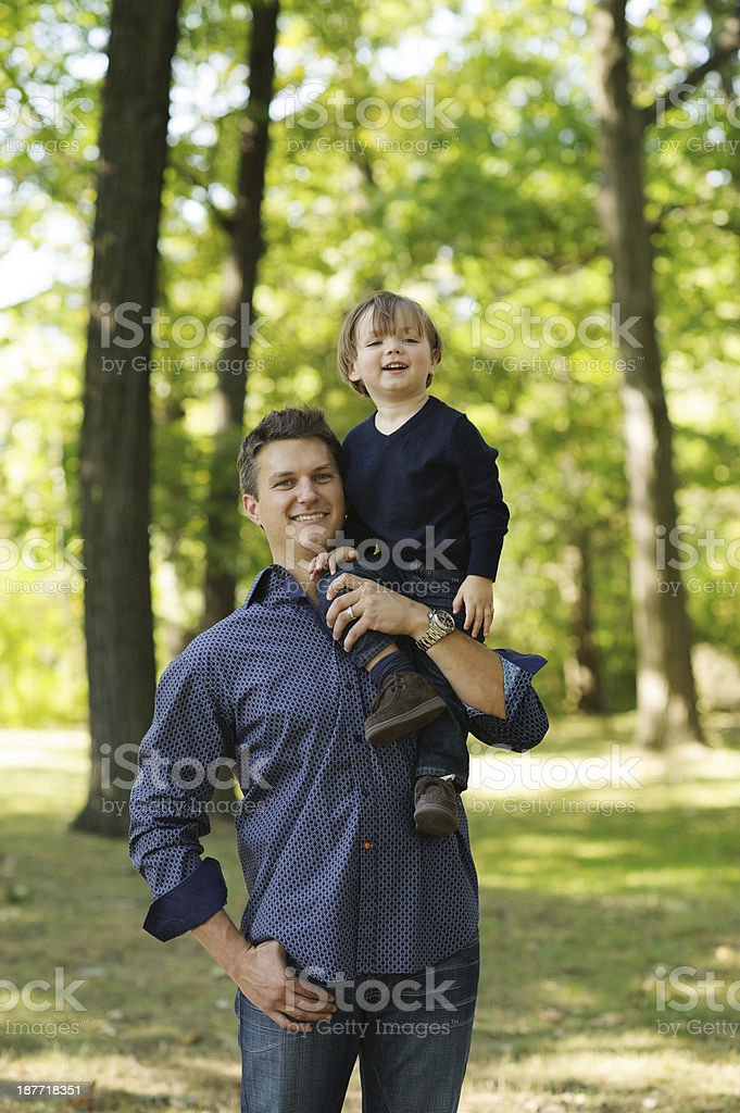 Dad Holding His Son Outside royalty-free stock photo