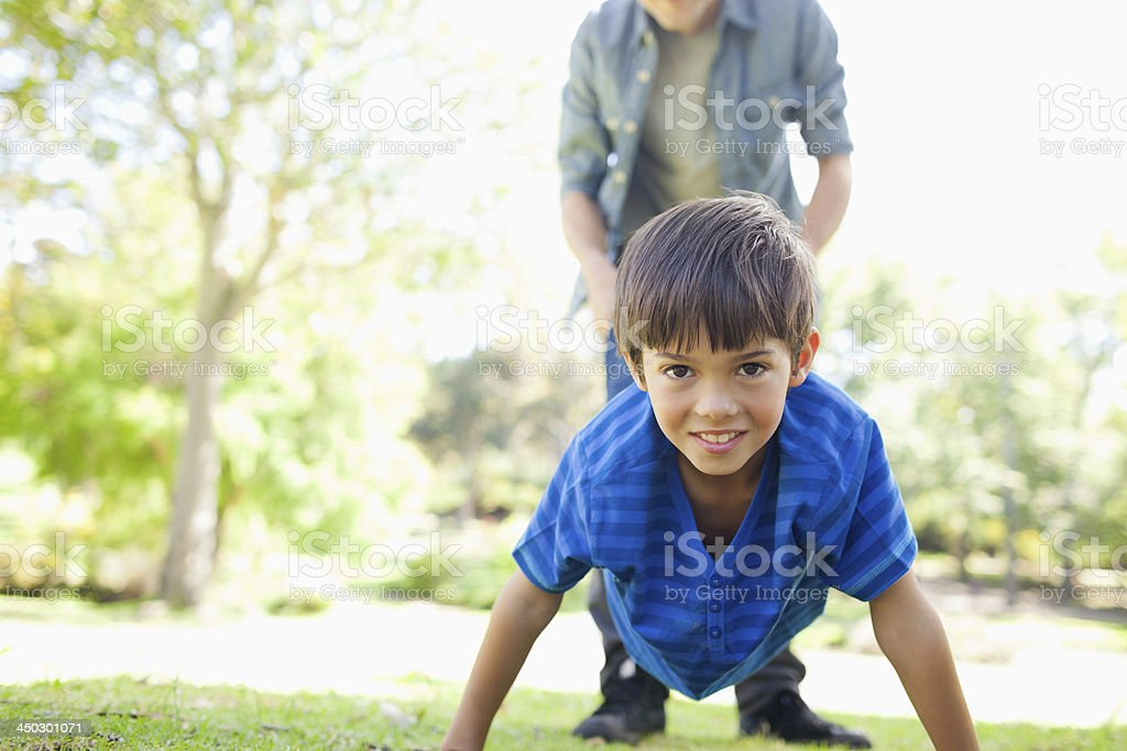 Dad holds his son's feet up stock photo