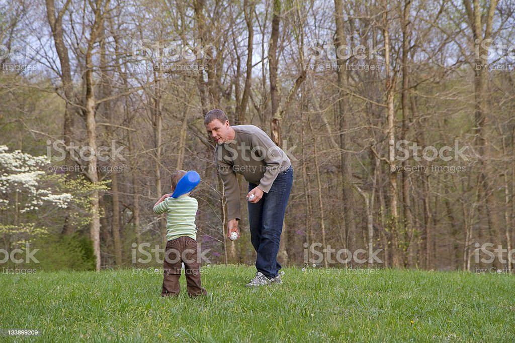 Dad pitches to his son royalty-free stock photo