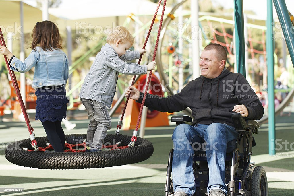Dad play with son and daughter stock photo