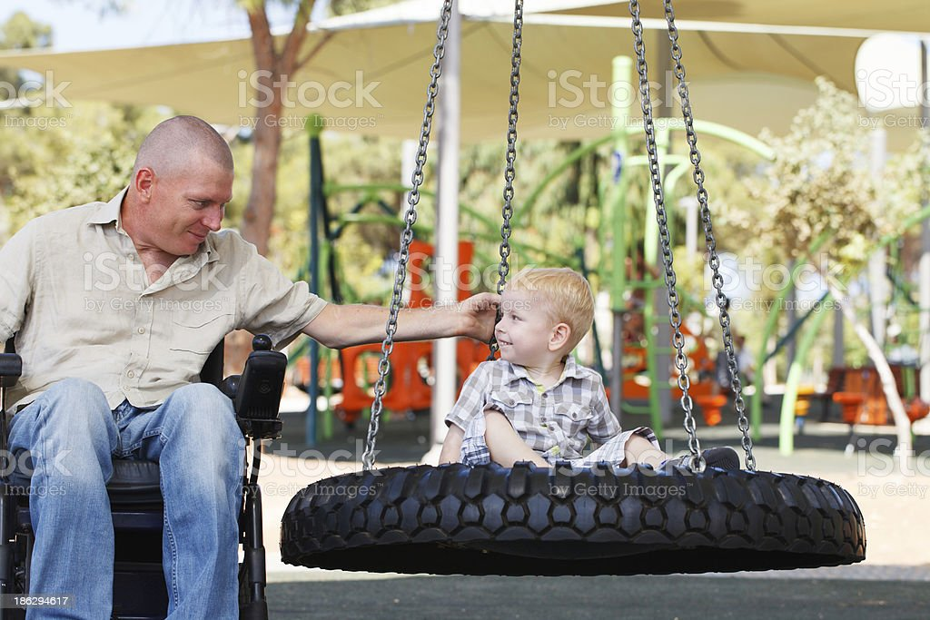 Dad play with son outdoor at park royalty-free stock photo