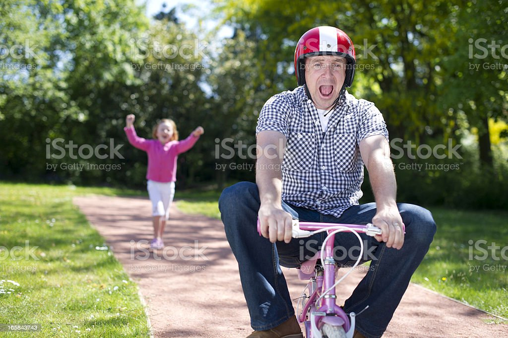 Dad riding solo stock photo