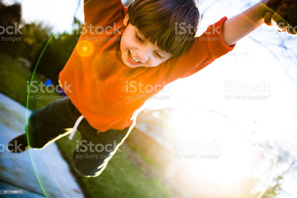 Dad Spining Kid Around stock photo