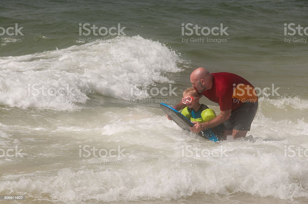 Dad Teaches How to use a Boogie Board stock photo