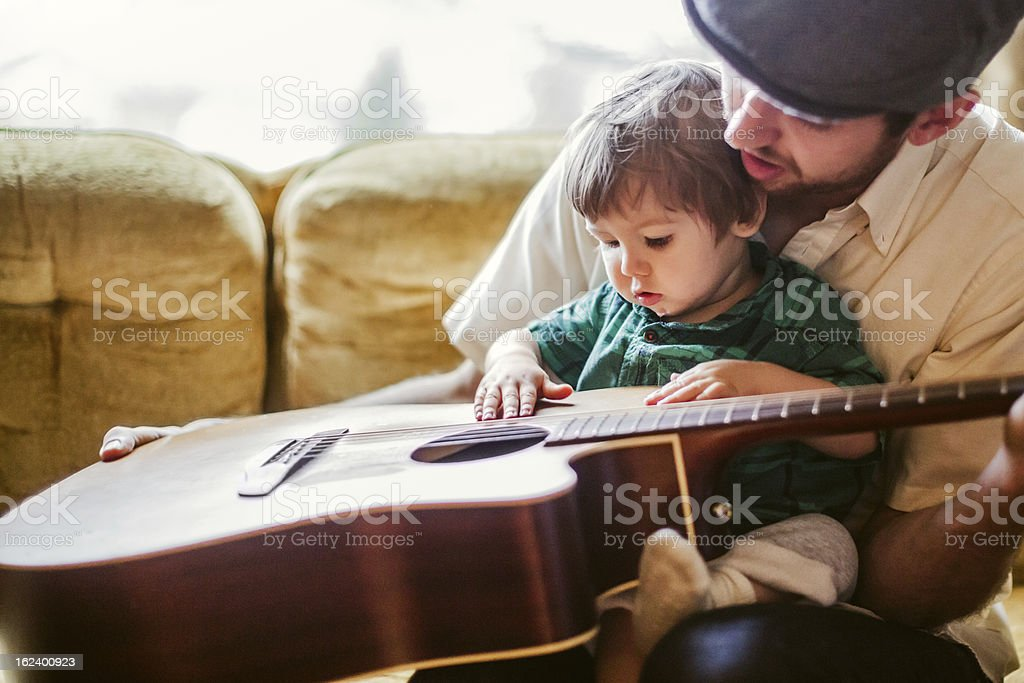 Dad Teaching Toddler to Play Instrument royalty-free stock photo