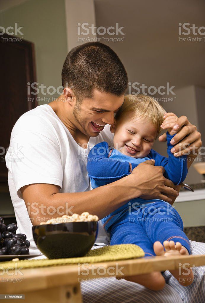 Dad tickling son. royalty-free stock photo