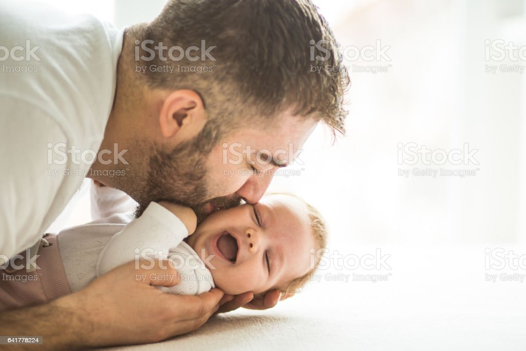 Dad with baby girl stock photo