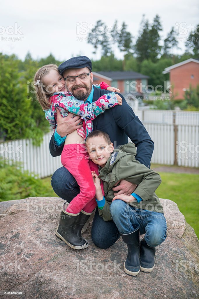 Dad with kids outdoors. stock photo