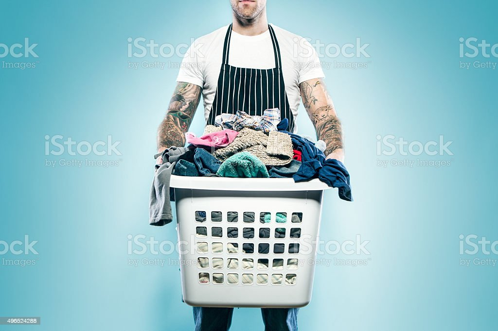 Dad with Tattoos Does Laundry stock photo