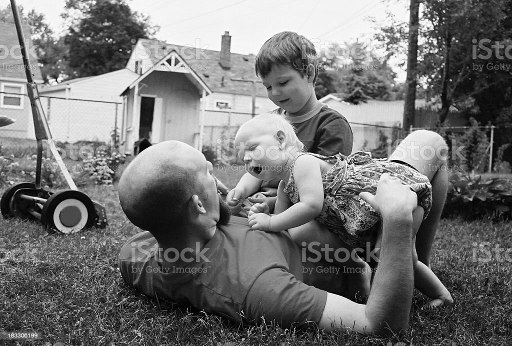 dad wrestles stock photo