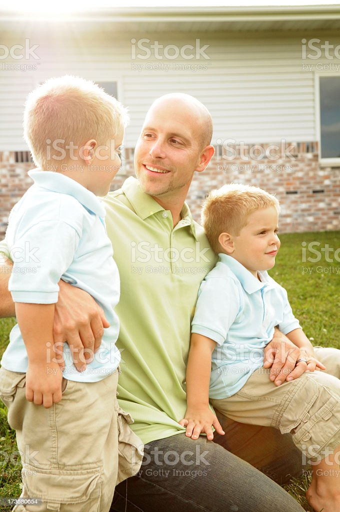 Daddy & His Boys royalty-free stock photo