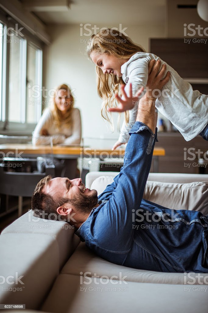 Daddy, I can fly! stock photo