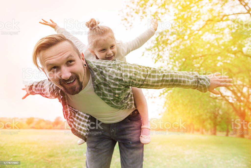 Daddy please, let's fly together stock photo