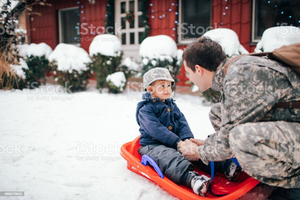 Daddy soldier's back for Christmas stock photo