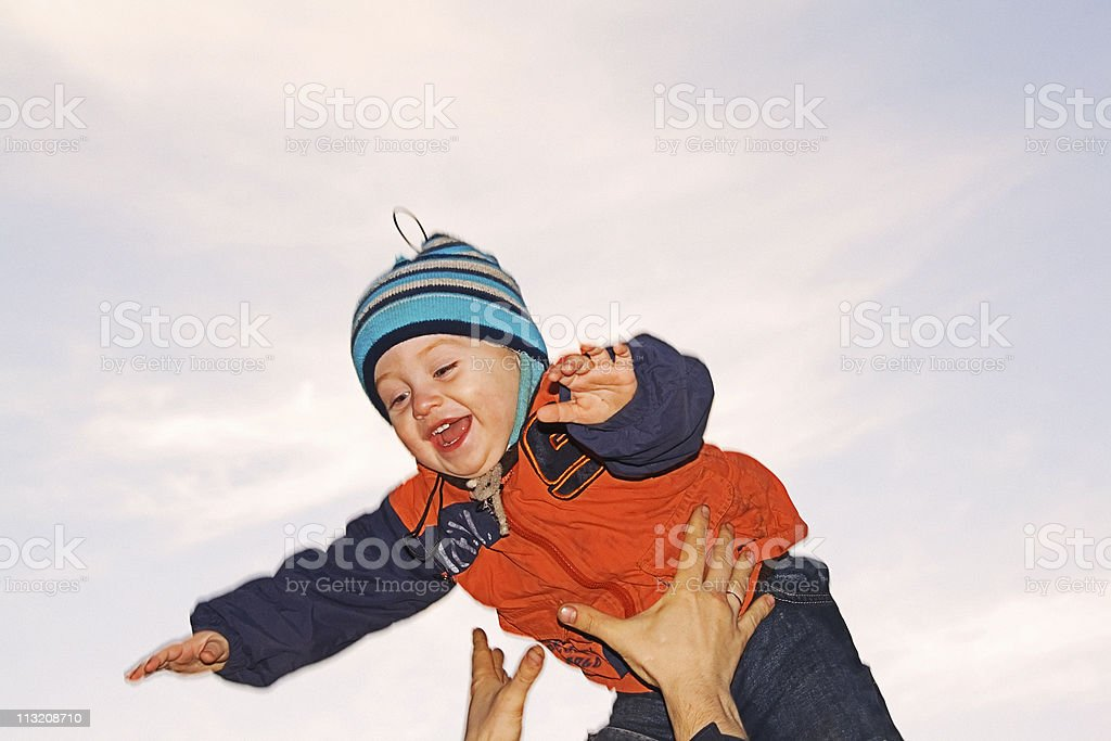 daddy throws the son royalty-free stock photo
