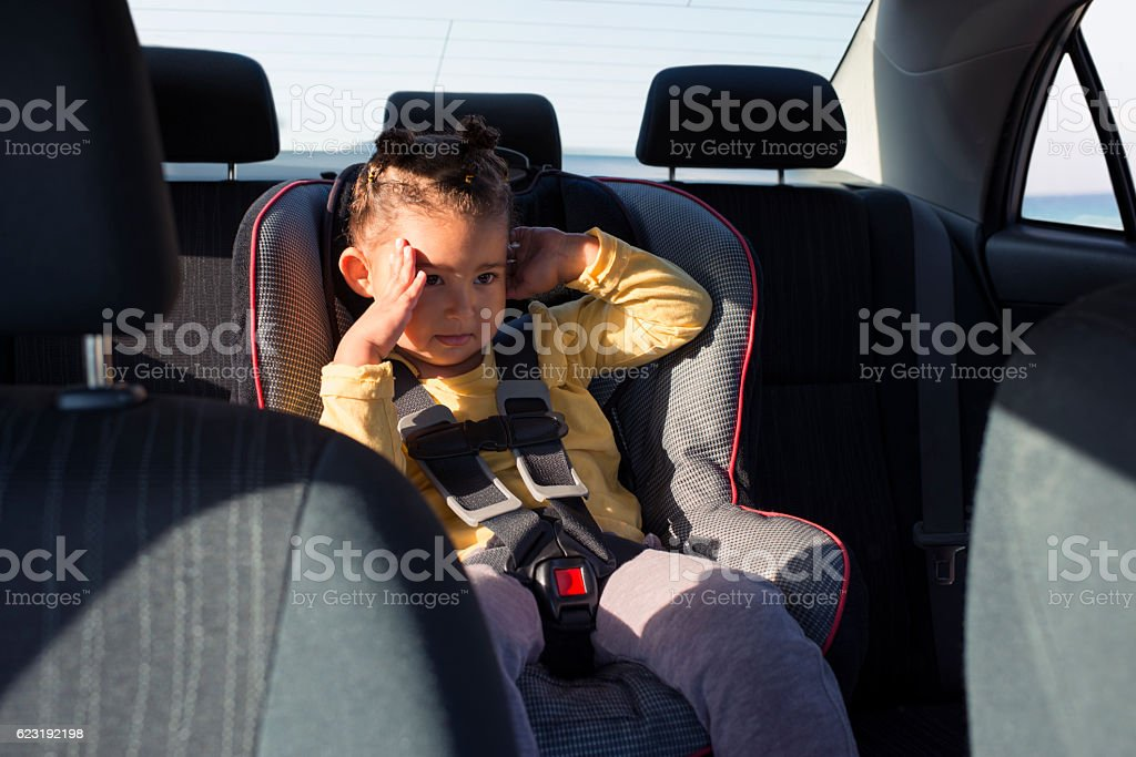 Daddy's car needs window shades! stock photo