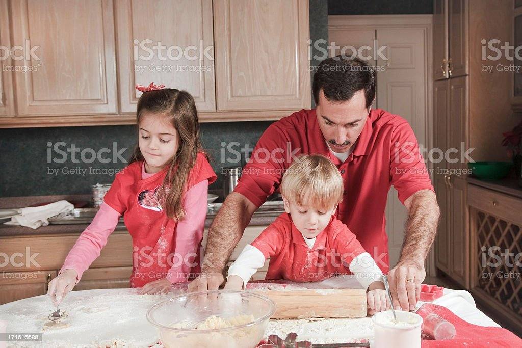 Daddy's Little Helpers stock photo