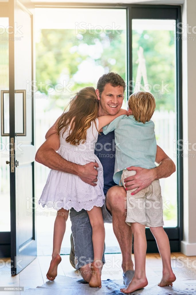 Dad's always greeted by tons of love stock photo