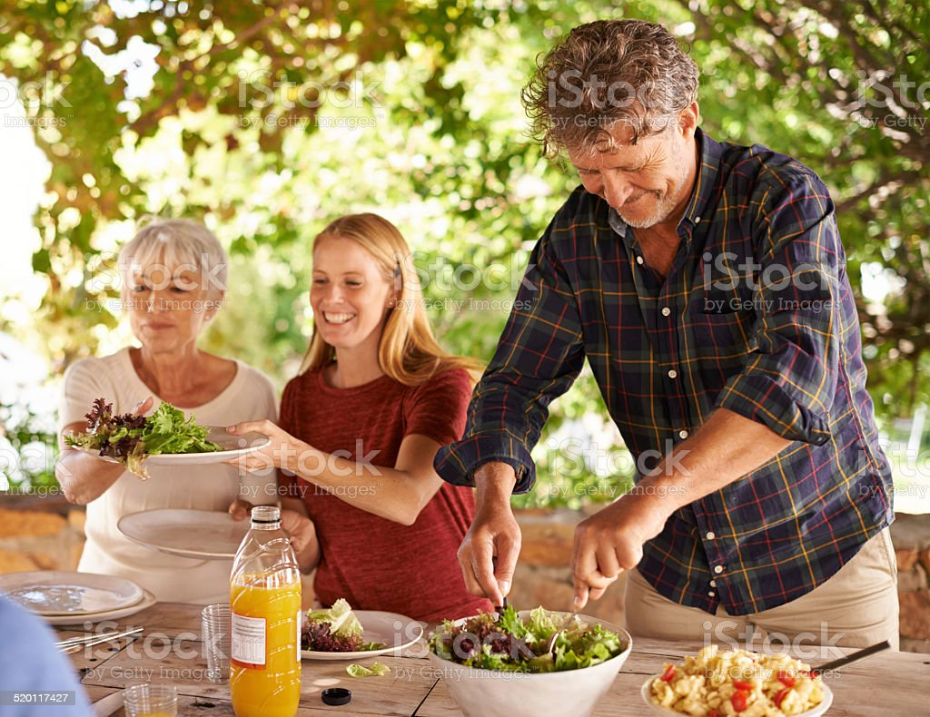 Dad's in charge of dishing up stock photo