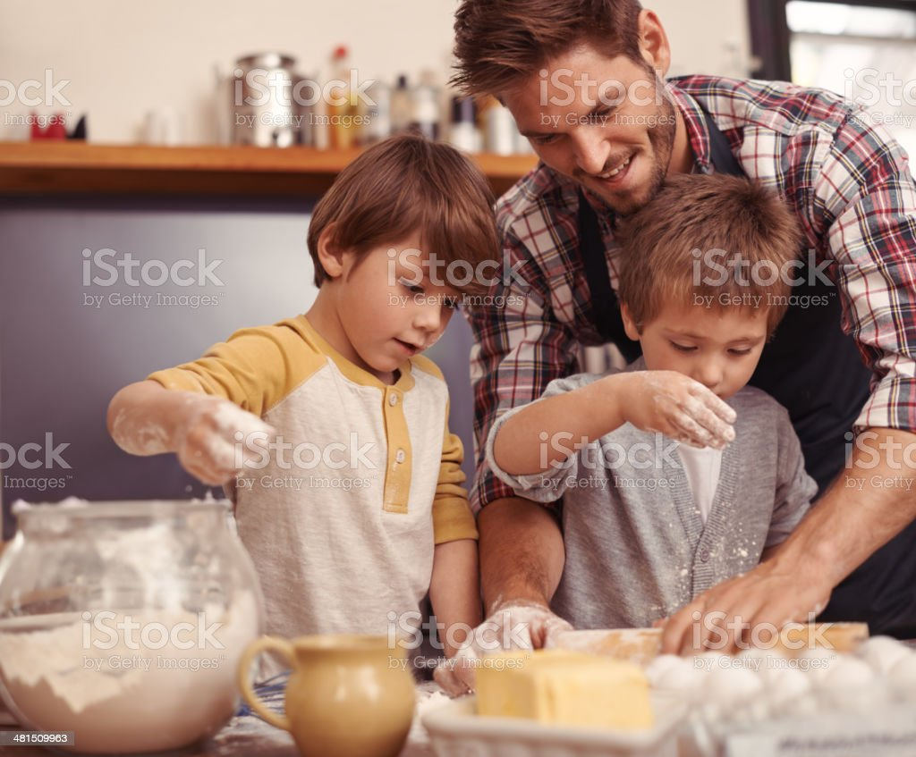 Dad's little bakers! stock photo