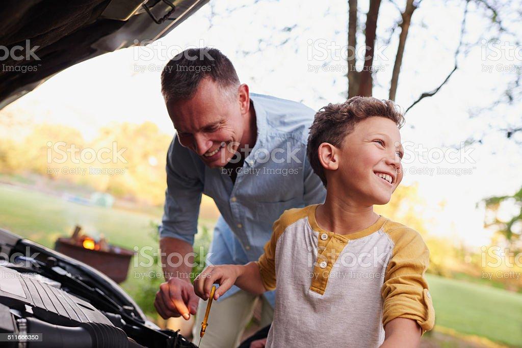 Dad's little helper stock photo