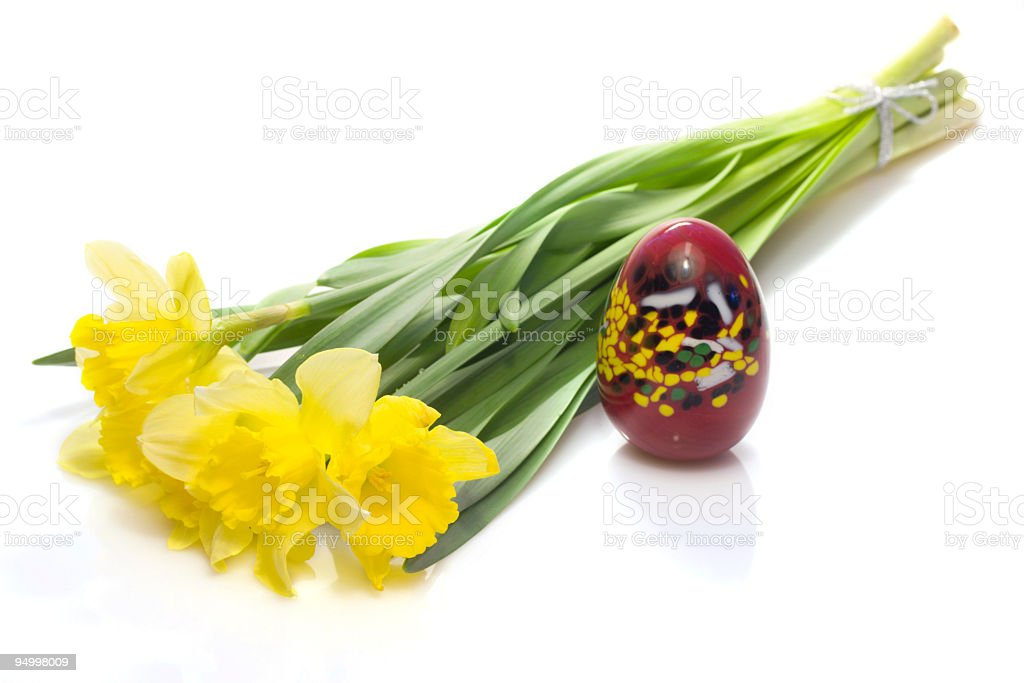 Daffodils and a colorful egg royalty-free stock photo