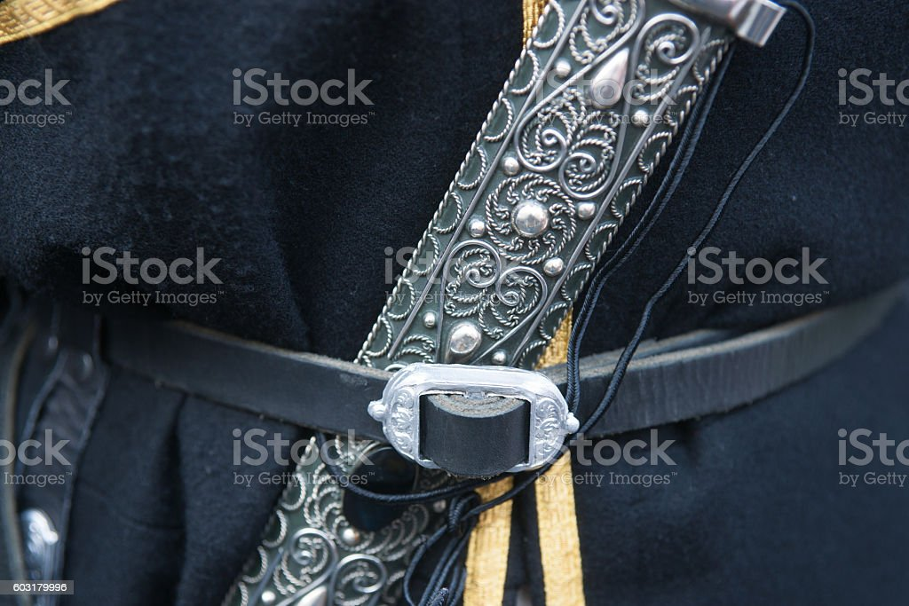 Dagger - an attribute of a Caucasian male suit stock photo