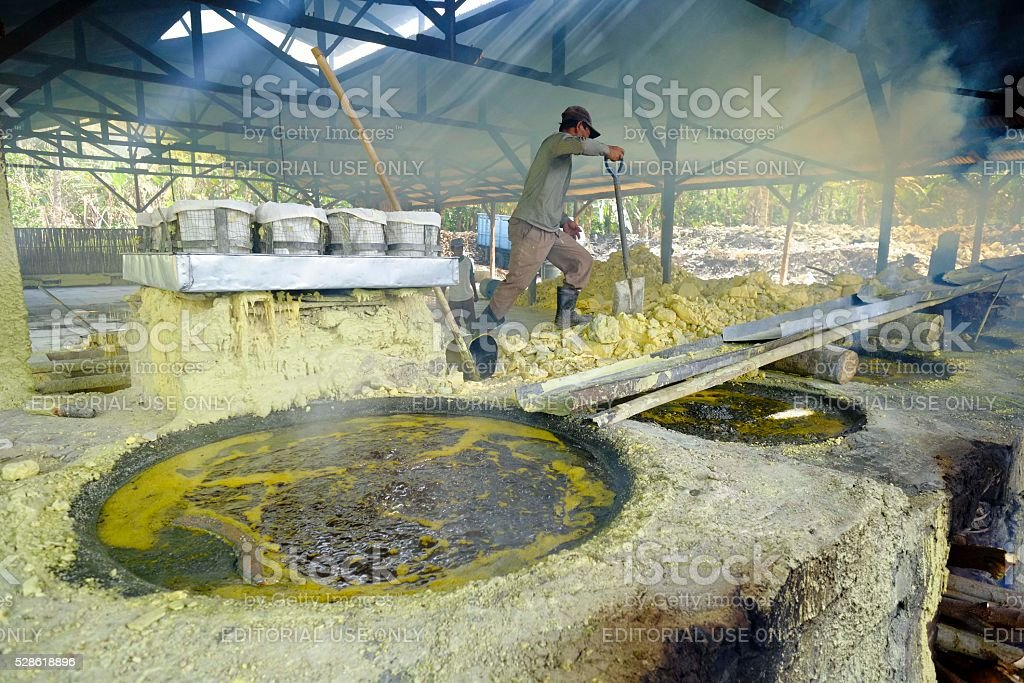 Daily activity inside the traditional sulphur factory in Ijen stock photo