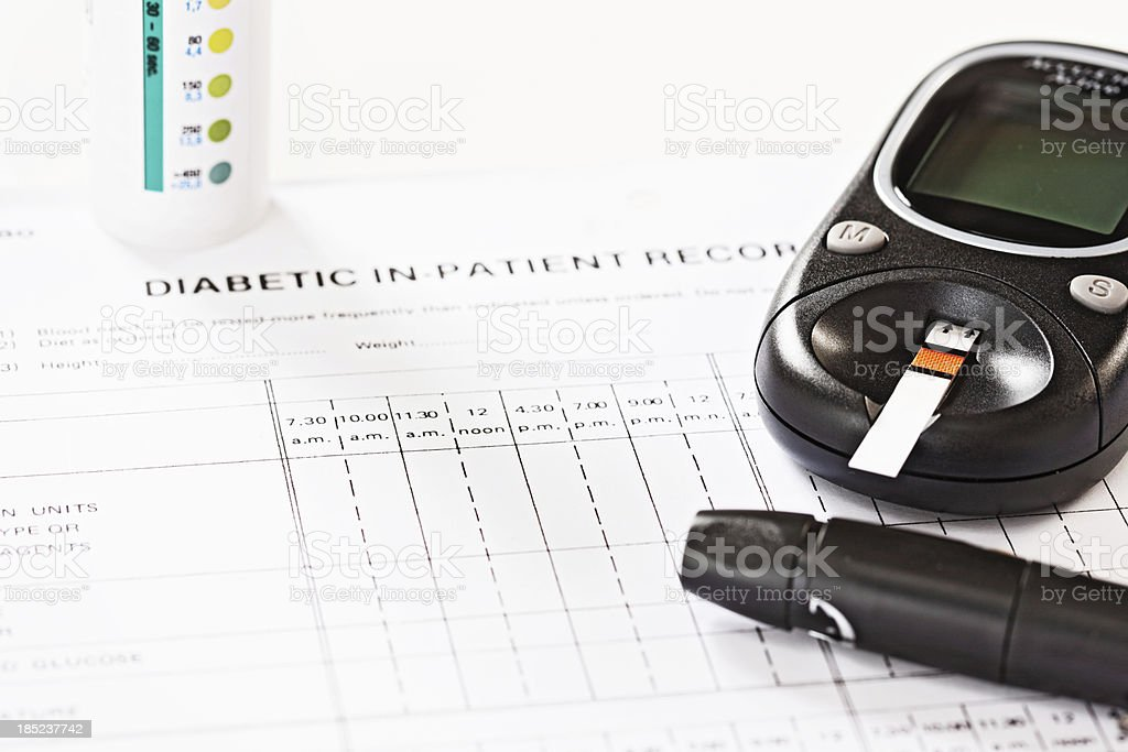 Daily diabetic kit: chart, test strips, glucometer and automatic lancet stock photo
