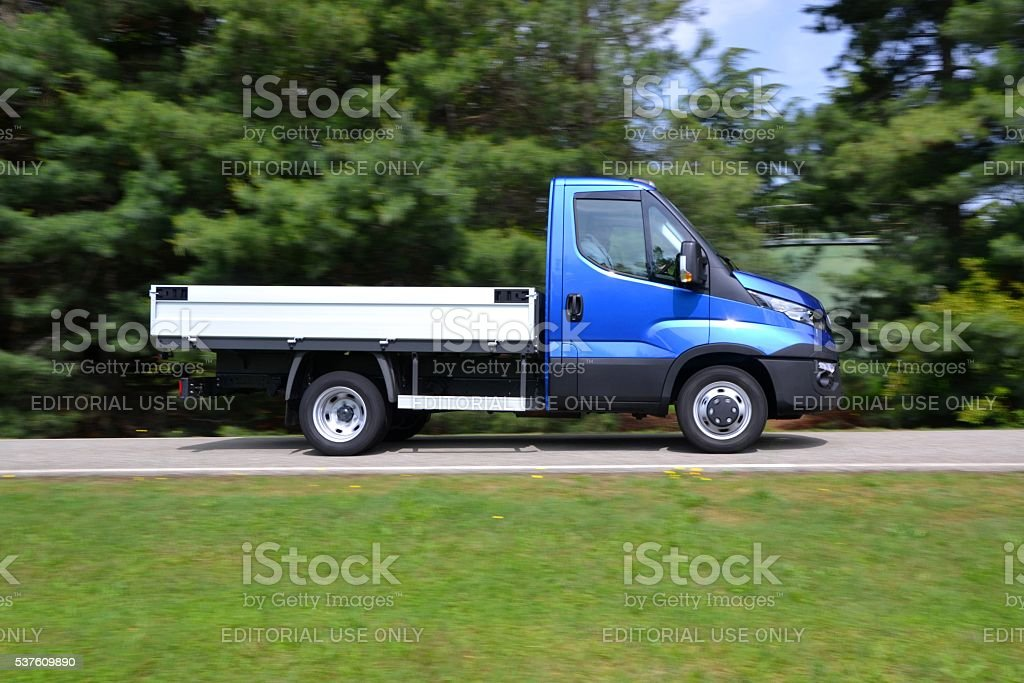 IVECO Daily driving on the street stock photo