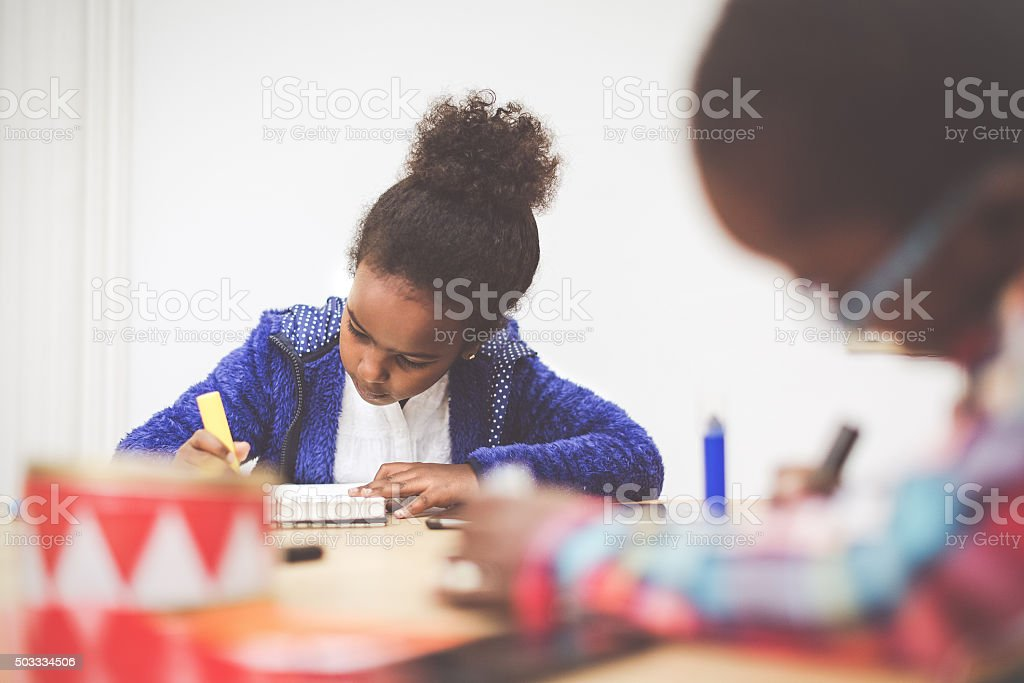 daily life of a child: the homework at home stock photo