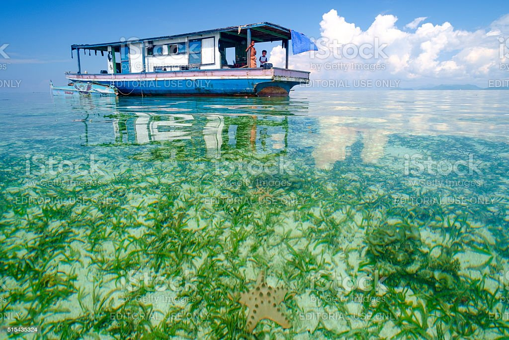Daily life of unidentified seagypsy people in Mabul Island. stock photo