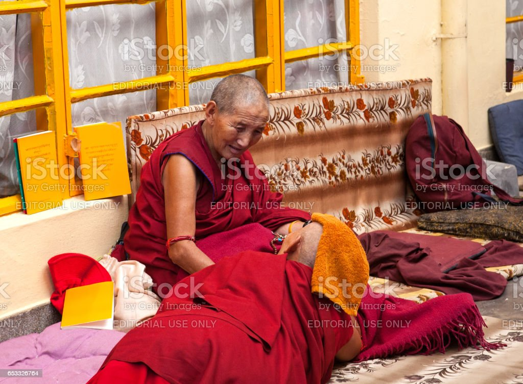 Daily lifestyle of the monks in a Buddhist monastery. A conversation between two Buddhist monks. stock photo