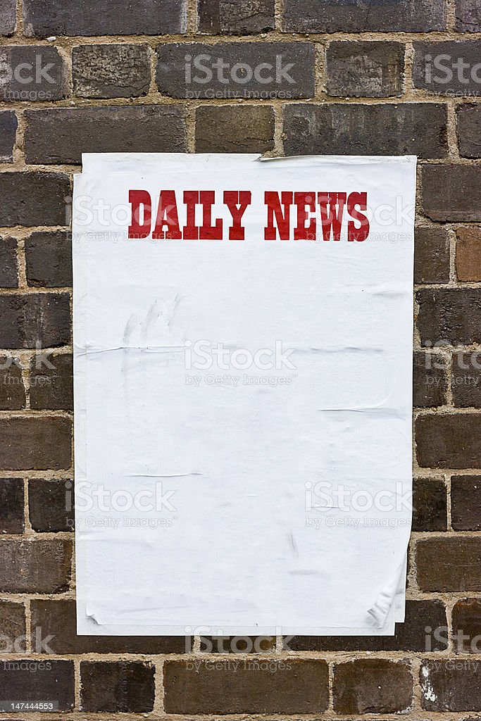 Daily News paper on an old brick wall. royalty-free stock photo